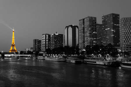 Paris, France, 2 June 2011 - Cityscape of Paris at night with the Eiffel Tower - Desaturated