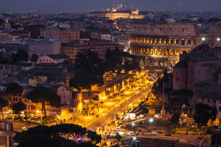colosseum: Cityscape of Rome at night.