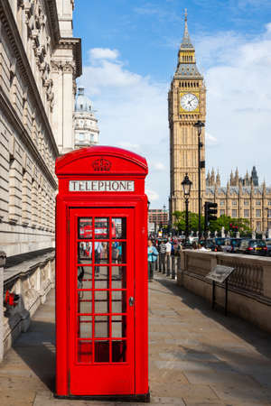 Traditional Red Telephone Box and Big Ben in London, UK
