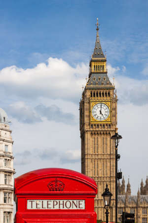 Traditional Red Telephone Box and Big Ben in London, UK photo