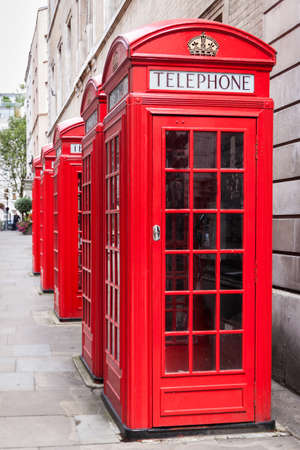 Traditional red telephone booths in London photo