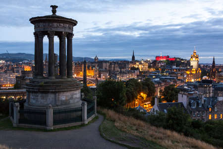 Edinburgh Skyline from Calton Hill at dusk, Scotland, UK photo