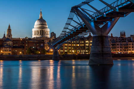 London, England, August 3, 2013 - St Paul Cathedral and Millennium Bridge at night