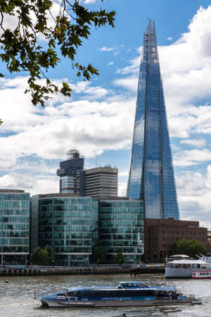 referred: London, England, August 4, 2013 - The Shard, also referred to as Shard London Bridge, is the tallest building in Europe, standing approximately 306 meters  Editorial