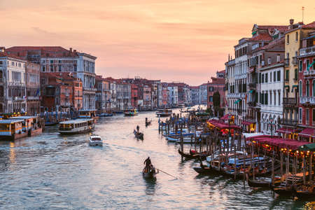 Amazing sunset over Grand Canal from Rialto Bridge in Venice, Italy photo