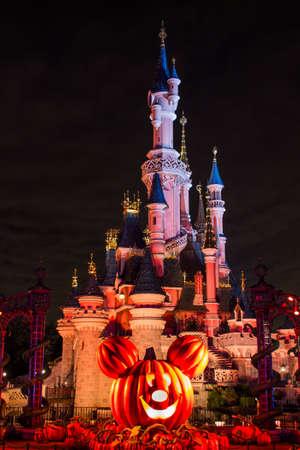 minnie mouse: Disneyland Paris Castle during Halloween Celebrations Editorial