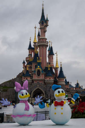 minnie mouse: Disneyland Paris Castle during Christmas Celebrations Editorial