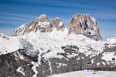 sella: View of the Sassolungo (Langkofel) Group of the Italian Dolomites in Winter from the Belvedere Ski Area in Canazei.