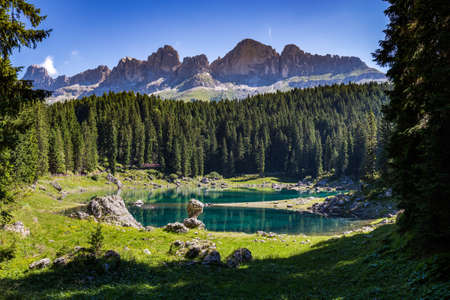 View of Karersee (Lago di Carezza), one of the most beautiful alpine lakes in the Italian Dolomites. Stock Photo