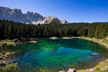 View of Karersee (Lago di Carezza), one of the most beautiful alpine lakes in the Italian Dolomites. Фото со стока