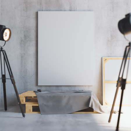 Mockup of vertical blank canvas on the wooden palletes with loft projectors. Art studio.