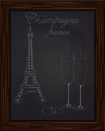 eifel tower: beautiful two glasses champagne and two wedding rings on the background Eifel Tower drawn in chlk