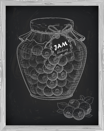 whortleberry: beautiful jar of homemade jam with blueberry on a black background drawn with chalk