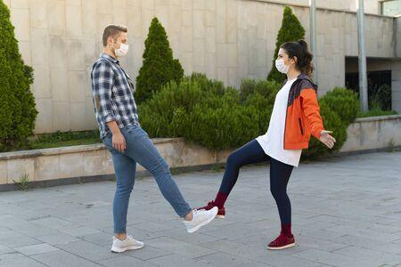 Young couple greeting with feet. Coronavirus epidemic. Covid 19 concept. Coronavirus prevention.