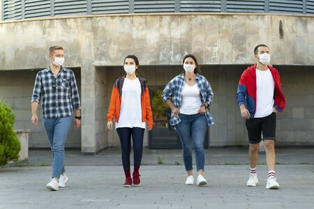 Group of multi-ethnic friends walking on the streets