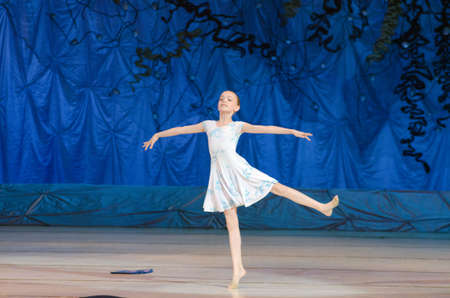 age 10: DNIPRO, UKRAINE - JUNE 26, 2016: An unidentified girl, age 10 years old, performs This eternal ballet tale at State Opera and Ballet Theatre.