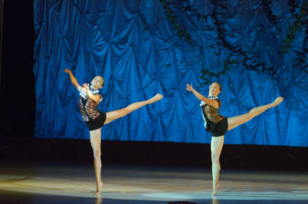 dnipro: DNIPRO, UKRAINE - JUNE 26, 2016: Sofia Gatylo  and Kira Tikhonov , ages 15 years old, perform This eternal ballet tale at State Opera and Ballet Theatre. Editorial