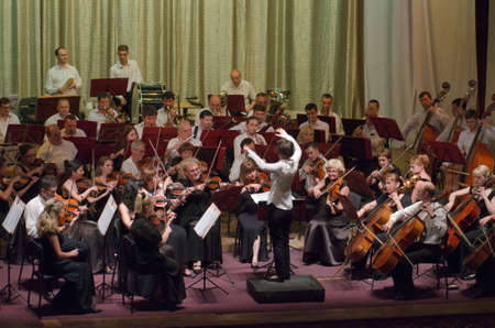 dnipro: DNIPRO, UKRAINE - JULY 1, 2016: Members of the Symphonic Orchestra - main conductor Natalia Ponomarchuk perform at the Potemkin Palace. Editorial