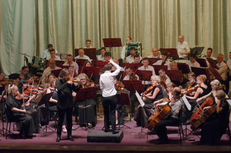 DNIPRO, UKRAINE - JULY 1, 2016: Famous Violinist Dmitry Tkachenko and Academic Symphony Orchestra - main conductor Natalia Ponomarchuk perform at the Potemkin Palace. Editorial