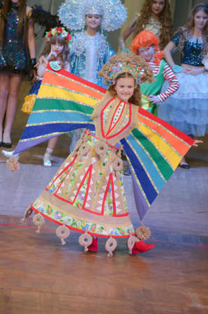age 10: DNIPROPETROVSK, UKRAINE - FEBRUARY 14, 2016: Unidentified girl, age 10 years old, performs Maslenitsa at the at the concert hall.