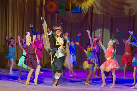 parable: DNIPROPETROVSK, UKRAINE - MARCH 10, 2016: Unidentified children, ages 4-13 years old, perform Once in the city� at the State Palace of children and youth.