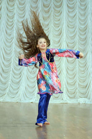 11 years: DNIPROPETROVSK, UKRAINE - FEBRUARY 21, 2016: Victoria Musienko, age 11 years old, performs East Dance at the Art Centre.