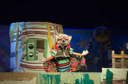 customary: DNIPROPETROVSK, UKRAINE - MAY 9, 2016: Rooster Kozakperformed by members of the Dnipropetrovsk Puppet Theatre. Editorial