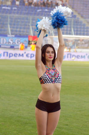 premier: DNIPRO, UKRAINE - JULY 31, 2016: Member of the Dance Team Dnipro performs during  the Premier League football match FC Dnipro against FC Stal.