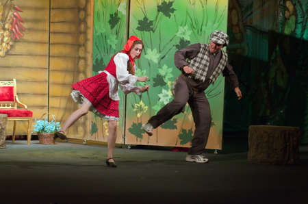 customary: DNIPROPETROVSK, UKRAINE - JUNE 14, 2015: Members of the Dnipropetrovsk State Russian Drama Theatre perform Curious Little Red Riding Hood.
