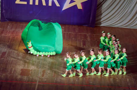 children caterpillar: DNIPROPETROVSK, UKRAINE - MARCH 22: Unidentified children, ages 3-5 years old, perform CATERPILLAR on March 22, 2015 in Dnipropetrovsk, Ukraine