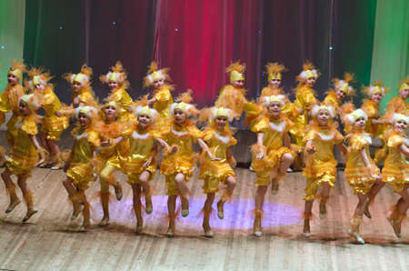 parable: DNIPROPETROVSK, UKRAINE - FEBRUARY 8: Unidentified children, ages 5-7 years old, perform CHICKEN on February 8, 2015 in Dnipropetrovsk, Ukraine