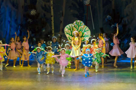 parable: DNIPROPETROVSK, UKRAINE - DECEMBER 25: Unidentified children, ages 4-13 years old, perform PUSHISTIKI at the State Palace of children and youth on December 25, 2014 in Dnipropetrovsk, Ukraine