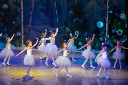 25 years old: DNIPROPETROVSK, UKRAINE - DECEMBER 25: Unidentified girls, ages 6-8 years old, perform SNOWFLAKES at the State Palace of children and youth on December 25, 2014 in Dnipropetrovsk, Ukraine Editorial