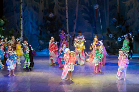 25 years old: DNIPROPETROVSK, UKRAINE - DECEMBER 25: Unidentified children, ages 4-13 years old, perform PUSHISTIKI at the State Palace of children and youth on December 25, 2014 in Dnipropetrovsk, Ukraine