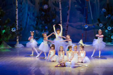 parable: DNIPROPETROVSK, UKRAINE - DECEMBER 25: Unidentified girls, ages 6-8 years old, perform SNOWFLAKES at the State Palace of children and youth on December 25, 2014 in Dnipropetrovsk, Ukraine Editorial