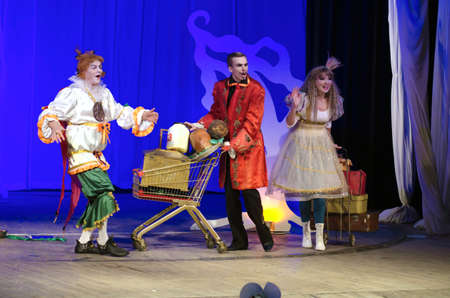 customary: DNIPROPETROVSK, UKRAINE - DECEMBER 19: Members of the Dnipropetrovsk State Russian Drama Theatre perform PUSS IN BOOTS on December 19, 2014 in Dnipropetrovsk, Ukraine