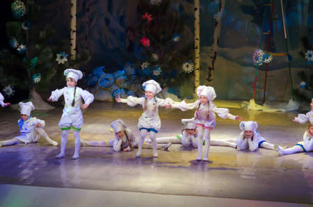 19 years old: DNIPROPETROVSK, UKRAINE - DECEMBER 19: Unidentified children, ages 7-10 years old, perform COOKS at the State Palace of children and youth on December 19, 2014 in Dnipropetrovsk, Ukraine Editorial
