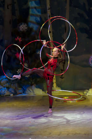 DNIPROPETROVSK, UKRAINE - DECEMBER 19: Unidentified girl, age 15 years old, performs HOOPS at the State Palace of children and youth on December 19, 2014 in Dnipropetrovsk, Ukraine