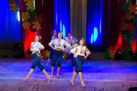parable: DNIPROPETROVSK, UKRAINE - OCTOBER 28: Unidentified children, ages 5-15 years old, perform UKRAINE at the State Palace of children and youth on October 28, 2014 in Dnipropetrovsk, Ukraine Editorial