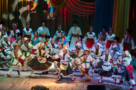 parable: DNIPROPETROVSK, UKRAINE - OCTOBER 1: Unidentified children, ages 4-15 years old, perform UKRAINE at the State Palace of children and youth on October 1, 2014 in Dnipropetrovsk, Ukraine