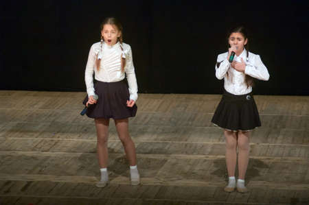 talker: DNIPROPETROVSK, UKRAINE - APRIL 12: Nana Shishkin and Anna Vozhzhin, ages 12 years old, perform TALKER at the State Palace of children and youth on April 12, 2014 in Dnipropetrovsk, Ukraine