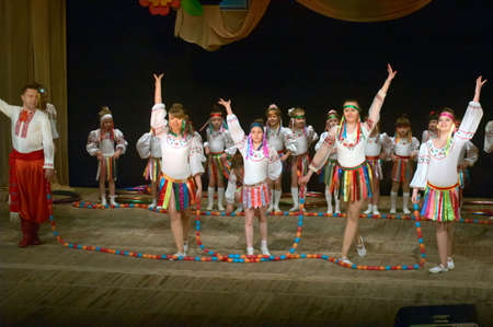 folk festival: DNIPROPETROVSK, UKRAINE - APRIL 12: Unidentified girls, ages 6-14 years old, perform FOLK FESTIVAL at the State Palace of children and youth on April 12, 2014 in Dneiropetrovsk, Ukraine