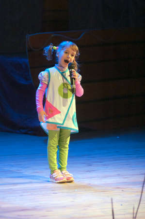 DNEPROPETROVSK, UKRAINE - JANUARY 4: Unidentified girl, age 6 years old, performs CHRISTMAS REGATTA at the Philharmonic on January 4, 2014 in Dnepropetrovsk, Ukraine