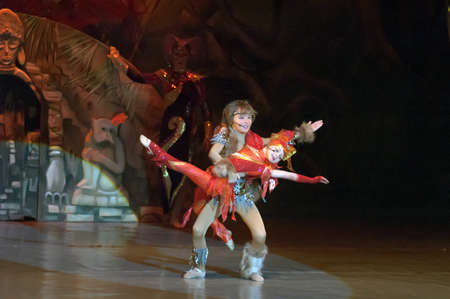 DNEPROPETROVSK, UKRAINE - FEBRUARY 23: Liza Yangel and Kirill Solovyev, ages 7 and 10 years old, perform musical spectacle Mowgli on February 23, 2013 in Dnepropetrovsk, Ukraine