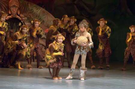 parable: DNEPROPETROVSK, UKRAINE - FEBRUARY 23: Unidentified children, ages 7-10 years old, perform musical spectacle Mowgli on February 23, 2013 in Dnepropetrovsk, Ukraine
