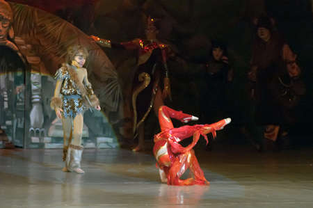 parable: DNEPROPETROVSK, UKRAINE - FEBRUARY 23: Liza Yangel and Kirill Solovyev, ages 7 and 10 years old, perform musical spectacle Mowgli on February 23, 2013 in Dnepropetrovsk, Ukraine