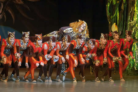 DNEPROPETROVSK, UKRAINE - FEBRUARY 23: Unidentified children, ages 14-15 years old, perform musical spectacle Mowgli on February 23, 2013 in Dnepropetrovsk, Ukraine Editorial