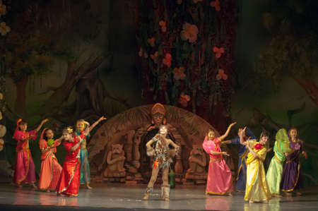 18 years old: DNEPROPETROVSK, UKRAINE - FEBRUARY 18: Unidentified children, ages 9-10 years old, perform musical spectacle Mowgli on February 18, 2013 in Dnepropetrovsk, Ukraine