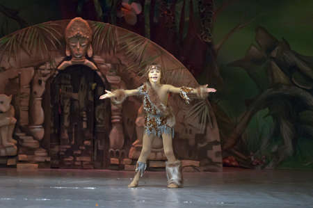age 10: DNEPROPETROVSK, UKRAINE - FEBRUARY 18: Kirill Solovyev, age 10 years old, performs musical spectacle Mowgli on February 18, 2013 in Dnepropetrovsk, Ukraine