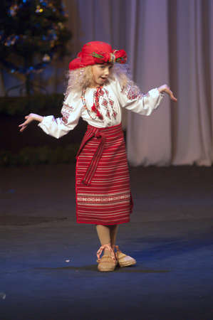 27 years old: DNEPROPETROVSK, UKRAINE - DECEMBER 27: Ira Booth, age 9 years old, performs Solokha on December 27, 2012 in Dnepropetrovsk, Ukraine